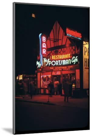 1945: Neon Lights Outside the Sportsman Cafe on 236 West 50th Street at Night, New York, NY-Andreas Feininger-Mounted Photographic Print