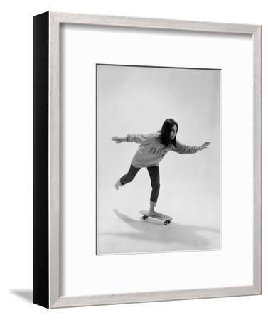 Studio Photos of Gloria Steinem Riding a Skateboard with a 007 James Bond Sweatshirt, 1965-Yale Joel-Framed Photographic Print