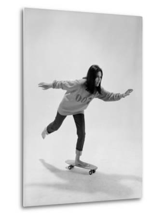 Studio Photos of Gloria Steinem Riding a Skateboard with a 007 James Bond Sweatshirt, 1965-Yale Joel-Metal Print