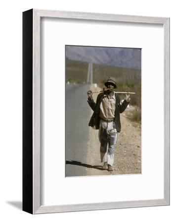 African Man Walks Along Side of Road, Durban, South Africa, 1960-Grey Villet-Framed Photographic Print
