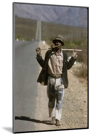 African Man Walks Along Side of Road, Durban, South Africa, 1960-Grey Villet-Mounted Photographic Print