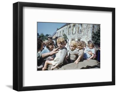 French Children in the Town of Avranches Sitting on Us Military Jeep, Normandy, France, 1944-Frank Scherschel-Framed Photographic Print