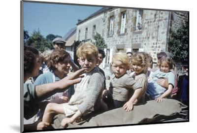 French Children in the Town of Avranches Sitting on Us Military Jeep, Normandy, France, 1944-Frank Scherschel-Mounted Photographic Print