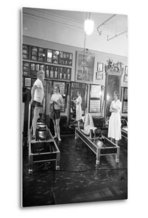 1951: Roberta Peters Working Out with Joseph Pilates and Others in a Studio, New York, NY-Michael Rougier-Metal Print
