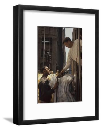 A Pair of Push Boys Unload Racks of Dresses on 7th Avenue, New York, New York, 1960-Walter Sanders-Framed Photographic Print