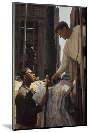 A Pair of Push Boys Unload Racks of Dresses on 7th Avenue, New York, New York, 1960-Walter Sanders-Mounted Photographic Print