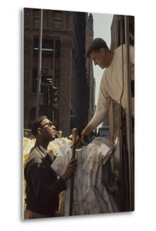 A Pair of Push Boys Unload Racks of Dresses on 7th Avenue, New York, New York, 1960-Walter Sanders-Metal Print