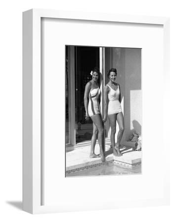 Celia Kyllingstad (R) and Carol Hall (L), at a Private Pool, Seattle, Washington, 1960-Allan Grant-Framed Photographic Print