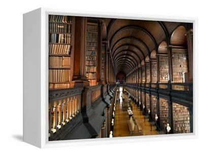 The Long Room in the Old Library at Trinity College in Dublin-Chris Hill-Framed Stretched Canvas Print