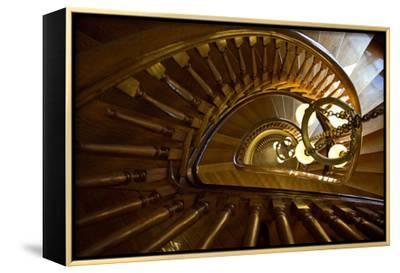 Looking Down a Spiral Staircase Past a Hanging Chandelier-Amy & Al White & Petteway-Framed Stretched Canvas Print