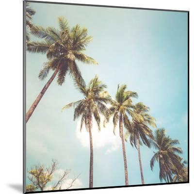 Coconut Palm Tree on Tropical Beach in Summer - Vintage Colour Effect-jakkapan-Mounted Art Print
