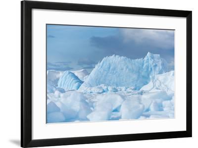 Blue Iceberg Floats Amidst Sea Ice in Fournier Bay, Antarctica-Jeff Mauritzen-Framed Photographic Print