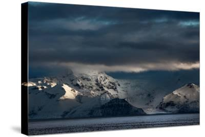 A Dramatic Sunrise over Mountains in Iceland-Alex Saberi-Stretched Canvas Print