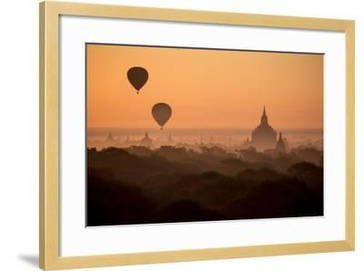 Hot Air Balloons Float Above the Terraces of a Buddhist Temple in Bagan-Cory Richards-Framed Photographic Print