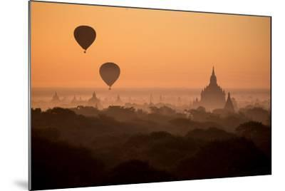 Hot Air Balloons Float Above the Terraces of a Buddhist Temple in Bagan-Cory Richards-Mounted Photographic Print