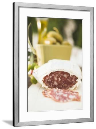 Salami and Green Olives on Table Out of Doors-Foodcollection-Framed Photographic Print