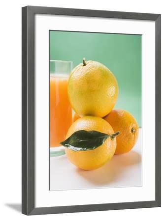Glass of Orange Juice Beside Several Oranges-Foodcollection-Framed Photographic Print