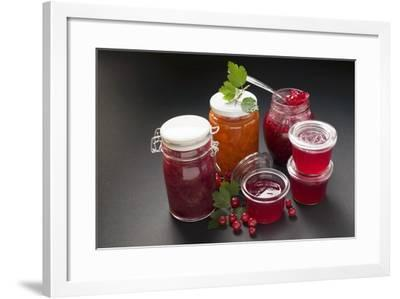 A Selection of Jams and Jelly in Jars, Redcurrants and Leaves-Foodcollection-Framed Photographic Print