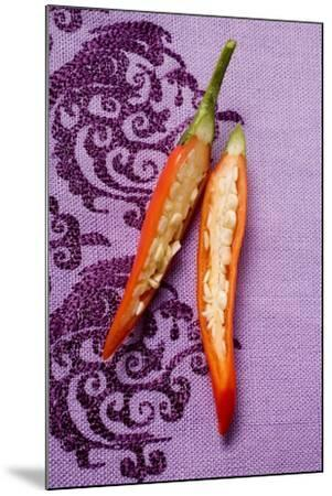 Red Chili Pepper, Halved, on Purple Fabric-Foodcollection-Mounted Photographic Print