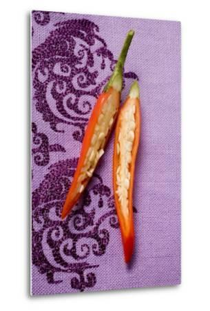 Red Chili Pepper, Halved, on Purple Fabric-Foodcollection-Metal Print