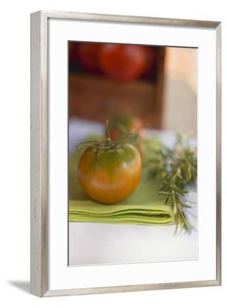 Green Tomatoes on Green Napkin on Table Out of Doors-Foodcollection-Framed Photographic Print