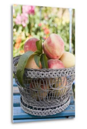 Basket of Fresh Peaches on a Garden Table-Eising Studio - Food Photo and Video-Metal Print
