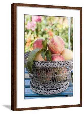 Basket of Fresh Peaches on a Garden Table-Eising Studio - Food Photo and Video-Framed Photographic Print