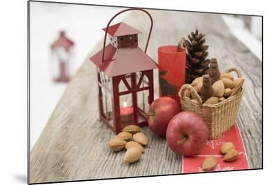 Christmas Decoration with Apples, Nuts and Lantern on Table-Foodcollection-Mounted Photographic Print