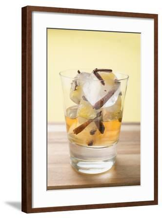 Rum and Ice Cubes with Spices and Pieces of Fruit in Glass-Foodcollection-Framed Photographic Print