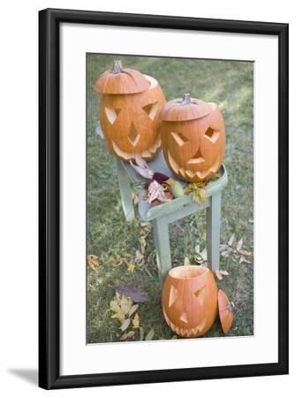 Carved Pumpkin Faces on Garden Table-Foodcollection-Framed Photographic Print