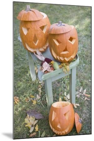 Carved Pumpkin Faces on Garden Table-Foodcollection-Mounted Photographic Print