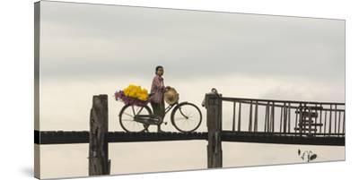 Myanmar, Mandalay. Woman Walks Her Flower-Laden Bicycle across U Bein Bridge-Brenda Tharp-Stretched Canvas Print