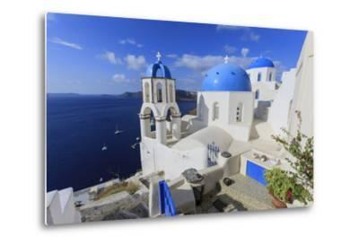 Blue Roofed Churches and Homes are Everywhere on the Island. Santorini. Greece-Tom Norring-Metal Print