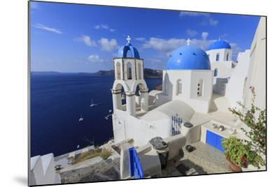 Blue Roofed Churches and Homes are Everywhere on the Island. Santorini. Greece-Tom Norring-Mounted Photographic Print