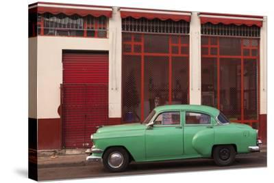 Cuba, Havana. Green Car, Red Building on the Streets-Brenda Tharp-Stretched Canvas Print