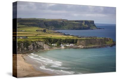 View over Village of Portbraddan and the North Coast of County Antrim, Northern Ireland, Uk-Brian Jannsen-Stretched Canvas Print