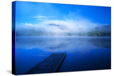 An Empty Dock on a Calm Misty Lake-John Alves-Stretched Canvas Print