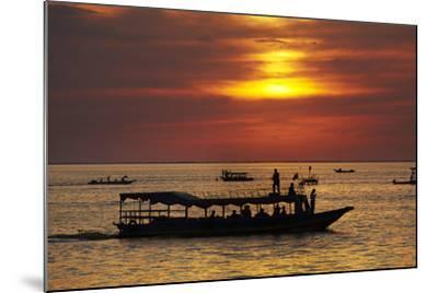 Sunset over Boats on Tonle Sap Lake at Chong Kneas Floating Village, Near Siem Reap, Cambodia-David Wall-Mounted Photographic Print