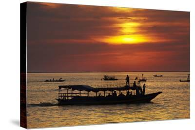 Sunset over Boats on Tonle Sap Lake at Chong Kneas Floating Village, Near Siem Reap, Cambodia-David Wall-Stretched Canvas Print