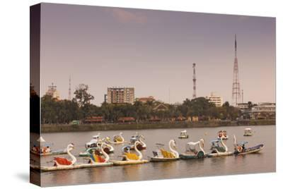 Vietnam, Hue. Perfume River and Tourist Swan Boats, Sunset-Walter Bibikow-Stretched Canvas Print