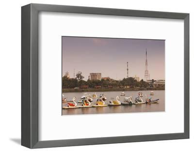 Vietnam, Hue. Perfume River and Tourist Swan Boats, Sunset-Walter Bibikow-Framed Photographic Print