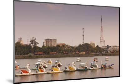 Vietnam, Hue. Perfume River and Tourist Swan Boats, Sunset-Walter Bibikow-Mounted Photographic Print