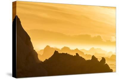 Norway, Svalbard, Nordaustlandet. Silhouette of Icebergs Backlit at Sunset-Jaynes Gallery-Stretched Canvas Print