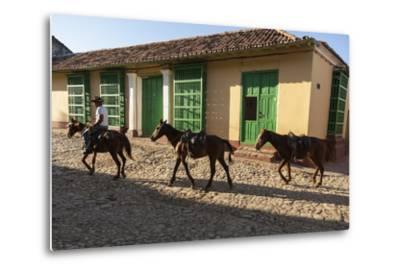 Cuba, Trinidad. Pulling Horses Along Cobblestone Street-Brenda Tharp-Metal Print