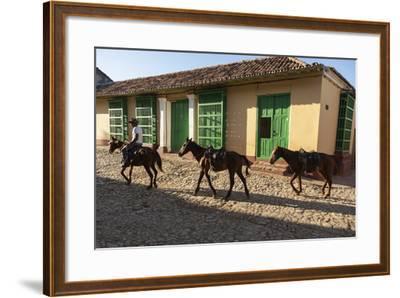 Cuba, Trinidad. Pulling Horses Along Cobblestone Street-Brenda Tharp-Framed Photographic Print