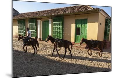 Cuba, Trinidad. Pulling Horses Along Cobblestone Street-Brenda Tharp-Mounted Photographic Print