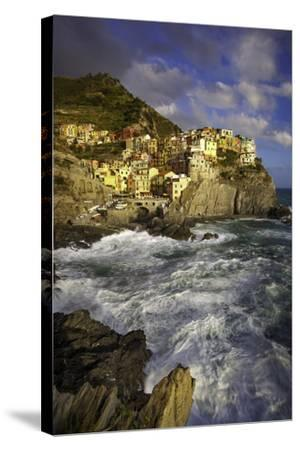 Swirling Ocean at the Foot of Medieval Town of Manarola in the Cinque Terre, Liguria Italy-Brian Jannsen-Stretched Canvas Print