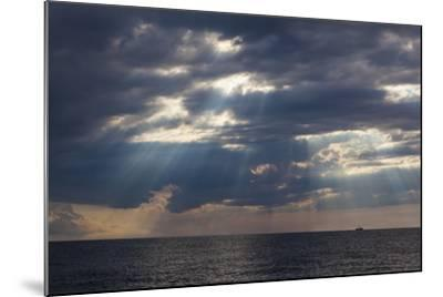 A Fishing Trawler under Storm Clouds at Duck Harbor Beach in Wellfleet, Massachusetts. Cape Cod-Jerry and Marcy Monkman-Mounted Photographic Print