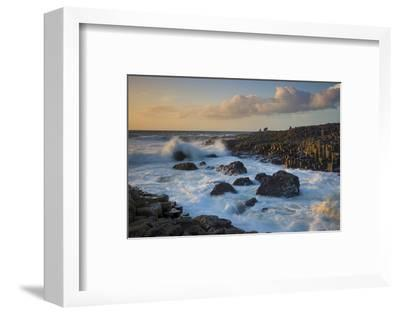 Tourist Watching the Setting Sun on the Giant's Causeway, County Antrim, Northern Ireland-Brian Jannsen-Framed Photographic Print