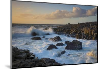 Tourist Watching the Setting Sun on the Giant's Causeway, County Antrim, Northern Ireland-Brian Jannsen-Mounted Photographic Print